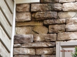freezing-damage-to-manufactured-stone-veneer-where-water-has-ran-down-the-front-wall