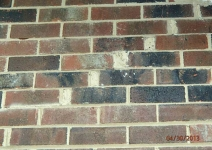 1-inch-wide-cracks-in-brick-venbeer-have-been-patched-with-caulkingh